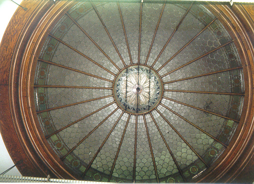 Stained-glass dome over original mahogany circulation desk, in Hazelwood Branch of The Carnegie Library of Pittsburgh